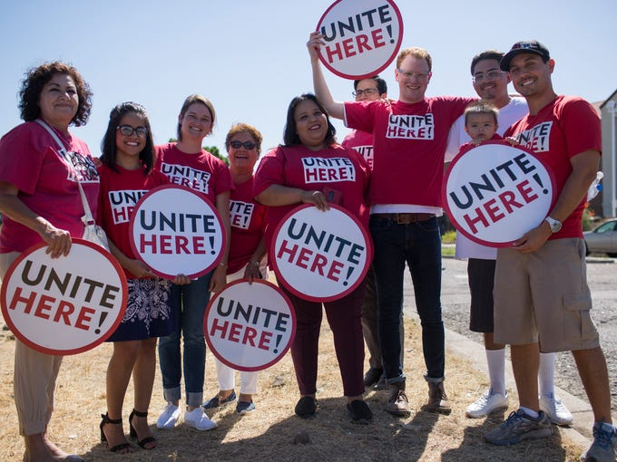 Protesters and members of the Unite Here hotel workers