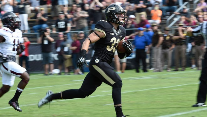 Purdue Boilermakers wide receiver Danny Anthrop (33) runs with a catch for a TD as Southern Illinois Salukis cornerback Keith Suggs (11) follows at Ross Ade Stadium.