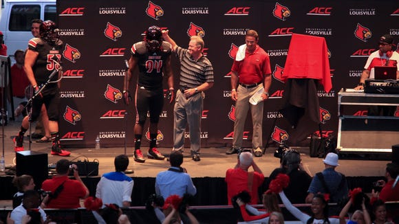 U of L head football coach Bobby Petrino announed a blackout game at Fourth Street Live.  July 1, 2014