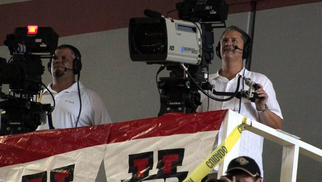 University of Kentucky head coach John Calipari took a turn manning the ESPNU tv camera during the team's exhibition game against Chalons-Reims of France in Nassau, Bahamas, August 11, 2014. Photo by Dana Fritz/Special to the Courier Journal
