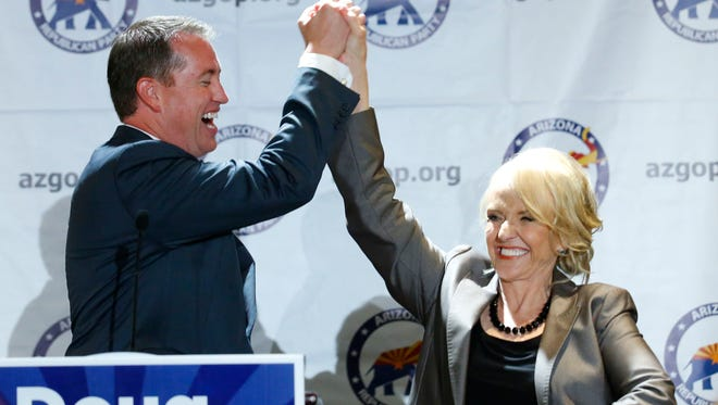 Jef DeWit, the Republican candidate for state Treasurer, celebrates his victory in the primary Tuesday night with Gov. Jan Brewer.