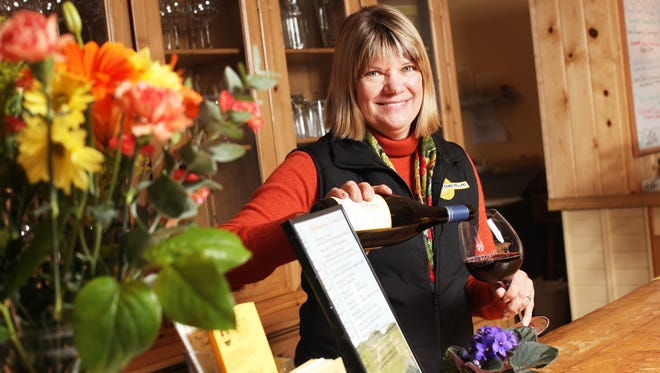 Suzanne Larson, owner of Left Coast Cellars, is seen in her winery's tasting room. The winery will hold a Mother's Day brunch.