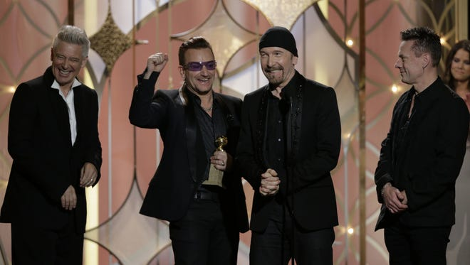 Adam Clayton, Bono, The Edge and Larry Mullen, Jr. of U2 win the Golden Globe for best original song from a motion picture with their 'Ordinary Love' from the movie 'Mandela: Long Walk to Freedom' on Jan. 12, 2014.