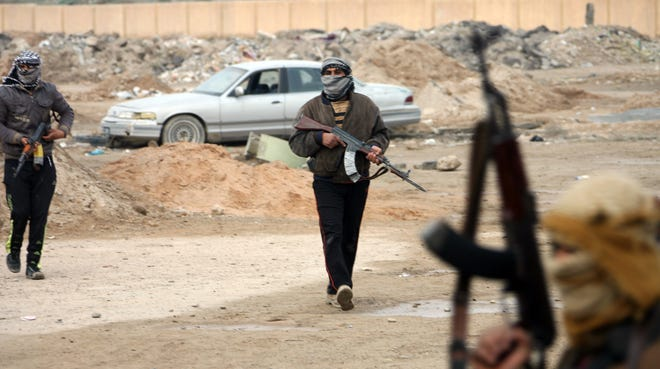 Gunmen patrol after clashes with police in Fallujah, west of Baghdad, on Jan. 5, 2014.