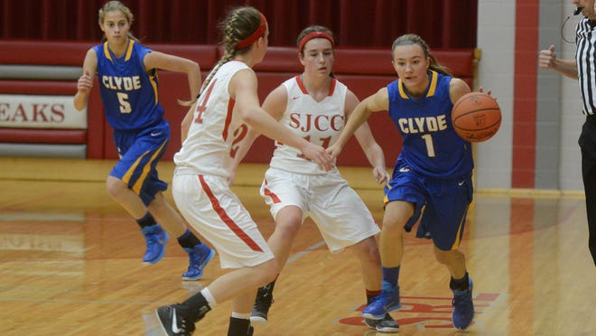 Clyde's Melissa Laconis is pressured by Fremont SJCC's Be Reardon and Callie Kelbley during the first half of a basketball game on Tuesday, Dec 2, 2014.