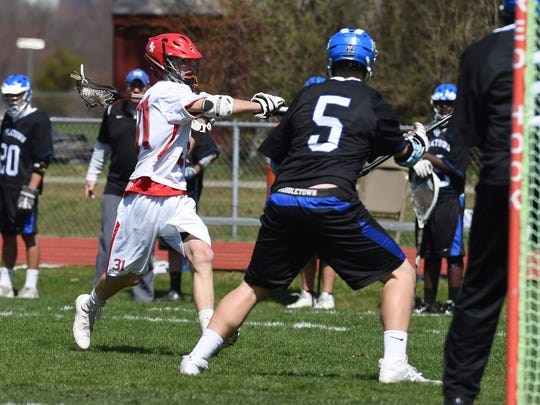 Red Hook's Liam O'Farrell, left, goes for a shot during Thursday's game against Middletown.