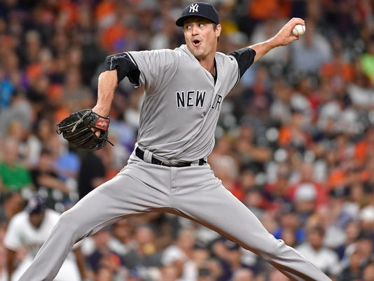 New York Yankees relief pitcher Andrew Miller delivers in the ninth inning of a baseball game against the Houston Astros, Monday, July 25, 2016, in Houston. (AP Photo/Eric Christian Smith)