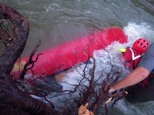 An Arkansas woman drowned in a June 12 incident in which her canoe was pinned underwater on the Buffalo River. Days later, officials removed the large root wad under which the canoe was pinned.