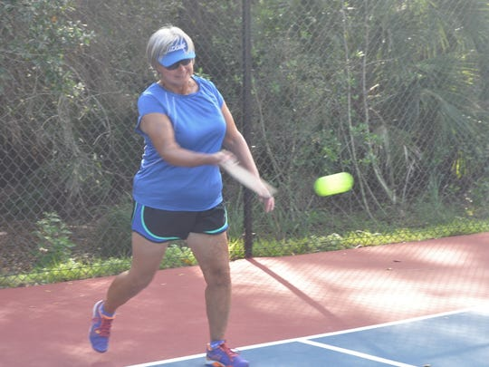 Sandy Metzler plays pickleball on the new courts at Veterans Park.