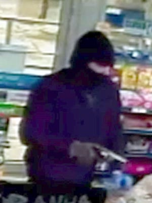 The Waukesha County Sheriff's Department is seeking information leading to the arrest of a man who at about 7:30 p.m. on Feb. 13 robbed the Clark gas station at N64 W23270 Main Street in Sussex. The department release this surveillance photo of the robbery.