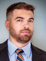 Jonathan Childress, co-owner of Proper Printshop Production,