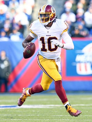 Redskins QB Robert Griffin III was up and down in relief of Colt McCoy on Sunday.
