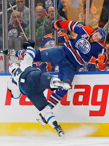 Oilers defensemen Eric Gryba (62) checks Jets forward