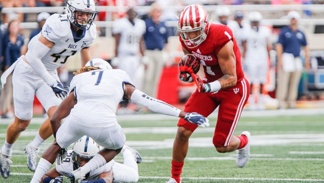Indiana's Simmie Cobbs Jr. (1) carries the ball against Charleston Southern's Brandon Rowland (7) during an NCAA college football game Saturday, Oct. 7, 2017, in Bloomington, Ind.