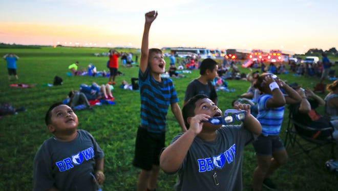 Students from the Brown School in Louisville watch the totality of the solar ellipse outside the James E. Bruce Convention Center in Hopkinsville, Kentucky, on Monday, Aug. 21, 2017.
