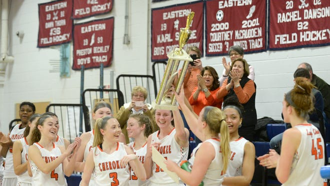 Cherokee players celebrate after defeating Shawnee 44-33 to capture the SJIBT championship on Sunday at Eastern High School. 02.18.18.