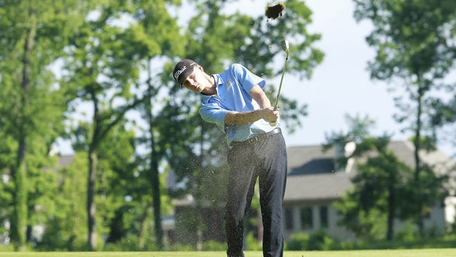 Menasha St. Mary's Grant Boyson hits a shot on No. 14 during the WIAA Division 3 state boys golf tournament Tuesday at University Ridge Golf Course in Madison.