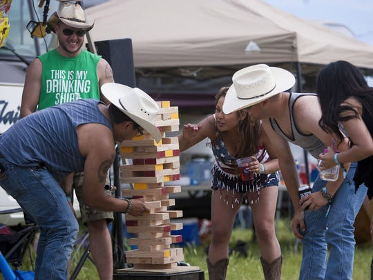 Country Thunder campers play a game of giant jenga