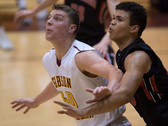 Gibson Southern's Wes Obermeier (40) is guarded by Southridge's Jaden Hayes (50) during their game on Feb. 1, 2018.