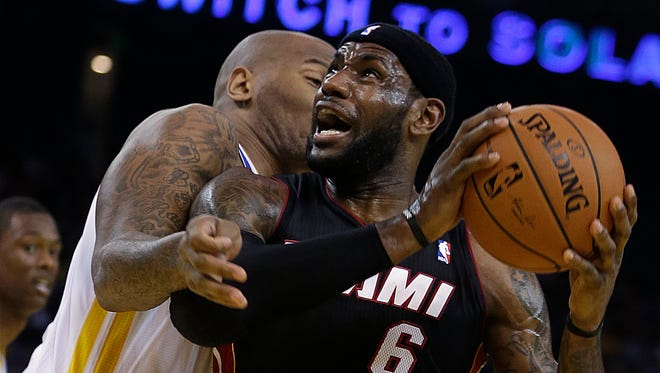 Miami Heat's LeBron James (6) drives the ball against Golden State Warriors' Marreese Speights during the first half of an NBA basketball game on Wednesday, Feb. 12, 2014, in Oakland, Calif.