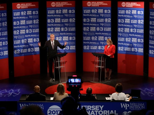 Democratic nominee Phil Murphy, left, answers a question