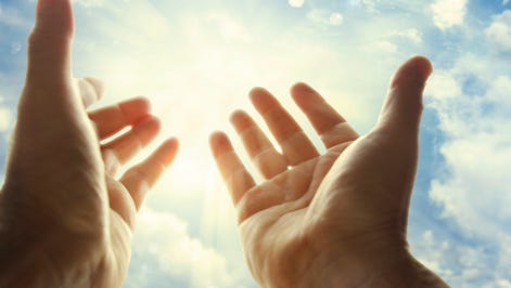 A stock image of hands in the sky.