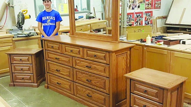 Brandon Boyles completed the final pieces of a bedroom set he has been working on throughout his high school career at Kiowa County High School in Greensburg.