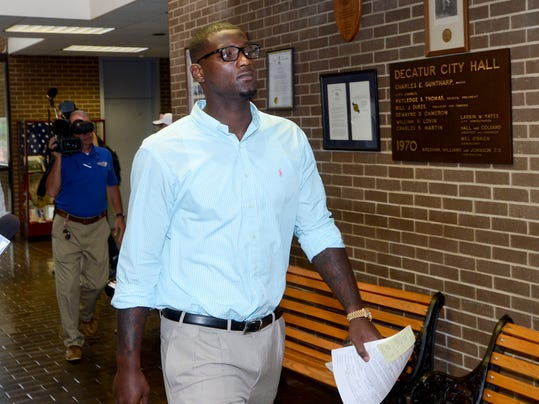 Dallas Cowboys linebacker Rolando McClain leaves court in Decatur, Ala., Friday, July 25, 2014. McClain was convicted of resisting arrest and disorderly conduct.. (AP Photo/The Decatur Daily, John Godbey)