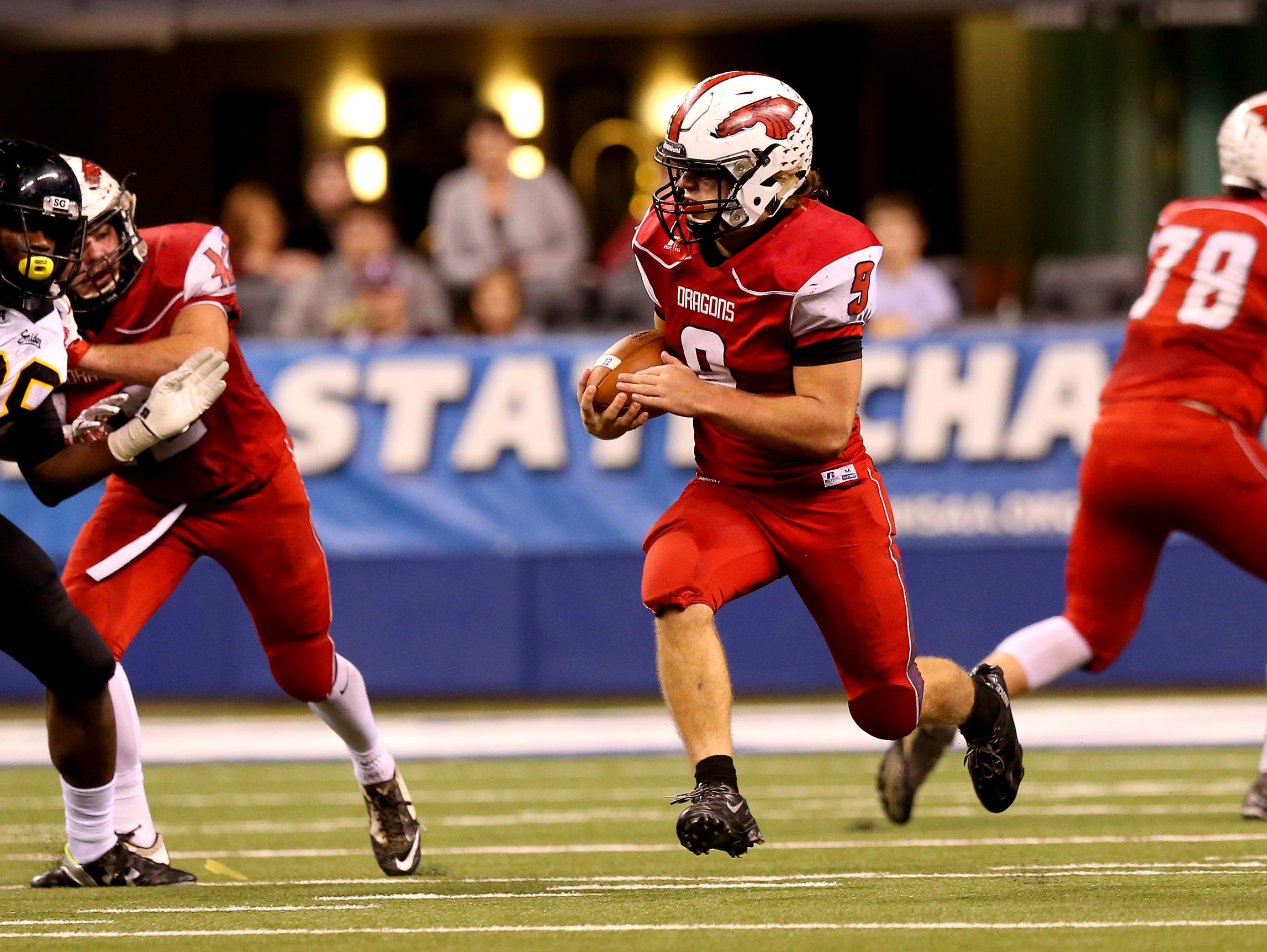 New Palestine's Adam Brickens looks for space during the Dragons' Class 5A state title loss last season.