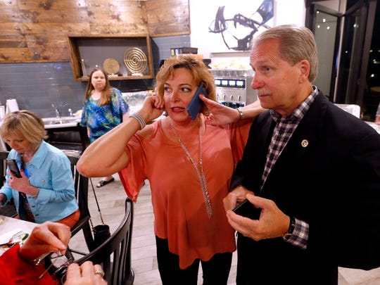 Donna Barrett, left and Bill Ketron watch for the results of the Republican primary for the Rutherford County Mayor's race on Tuesday, May 1, 2018, as Donna Barrett calls to confirm the results.