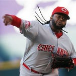 Cincinnati Reds starting pitcher Johnny Cueto works against the Colorado Rockies during the first inning of a baseball game Saturday, July 25, 2015, in Denver. (AP Photo/David Zalubowski)