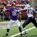 Minnesota Vikings quarterback Matt Cassel, left, throws under pressure from New England Patriots defensive end Chandler Jones during the fourth quarter of an NFL football game Sunday, Sept. 14, 2014, in Minneapolis. (AP Photo/Ann Heisenfelt)
