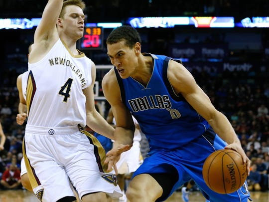 Dallas Mavericks forward Dwight Powell (8) drives against former New Orleans Pelicans guard Nate Wolters (4) during a Jan. 25 game in New Orleans.