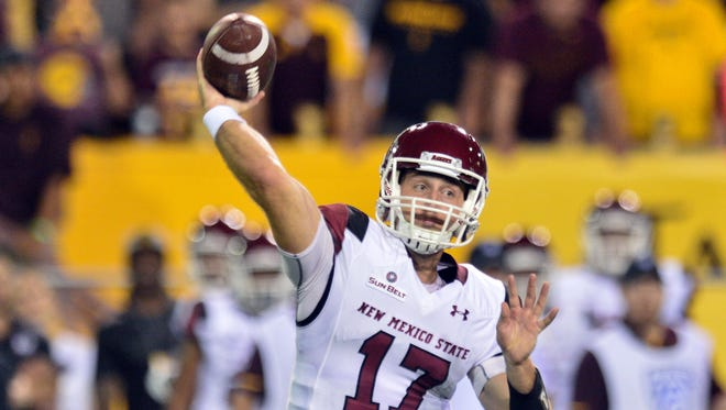 New Mexico State Aggies quarterback Tyler Rogers (17) throws during the first half against the Arizona State Sun Devils at Sun Devil Stadium.