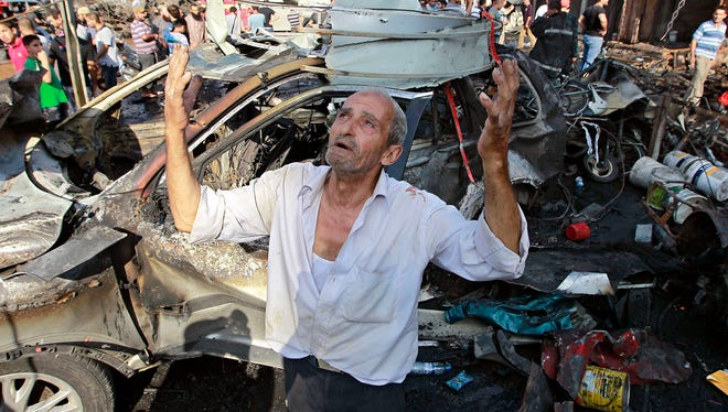 A man recites prayers amid the destruction after a car bomb outside the Al-Taqwa mosque in the northern city of Tripoli, Lebanon, Friday, Aug. 23, 2013. The twin car bombs, which killed dozens hit amid soaring tensions in Lebanon as a result of Syria's civil war, which has sharply polarized the country along sectarian lines and between supporters and opponents of the regime of Syrian President Bashar Assad. It was the second such bombing in just over a week, showing the degree to which the tiny country is being consumed by the raging war next door. (AP Photo/Bilal Hussein) ORG XMIT: XBH103