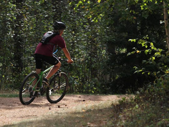 A mountain biker rides at Nine Mile County Forest Recreation