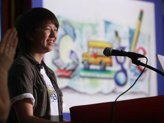 Edison High School student Cynthia Cheng is honored during an assembly, Wednesday, May 4, 2011, for being one of only 40 finalists out of 107,000 entries in an art contest for Google Doodle.