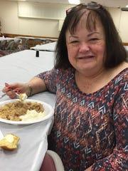 Fayetteville's Karen Wolfinger enjoys pork and sauerkraut at Fayetteville Volunteer Fire Department's annual New Year's Day sauerkraut dinner.
