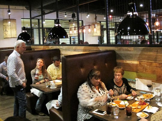 Owner Michael Hernandez, left, chats with guests at Public House, his restaurant and lounge that opened in January 2017 to anchor Creekside Corners on the southeast corner of Goodlette-Frank and Immokalee roads in North Naples. Another Hernandez restaurant, Midtown Kitchen + Bar, closed in July 2017.