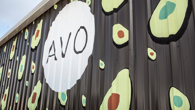 The exterior of AVO is painted with a pattern of avocado halves.