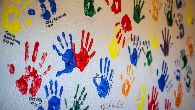 A wall with handprints of volunteers inside the Iron County Children's Justice Center in Cedar City.