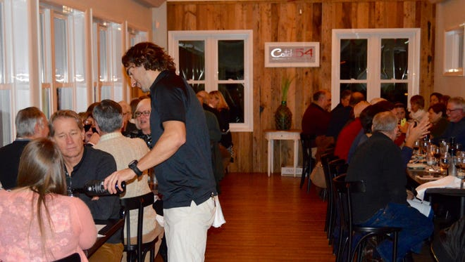 Guests dine at Catch 54 on Friday, Jan. 18, during a SoDel Concepts company wine dinner.