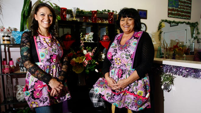Owners Ashlie Dixon, left, and Liz Cadle pose for a portrait Friday at Through an Angel's Eyes Floral Boutique in Bloomfield.