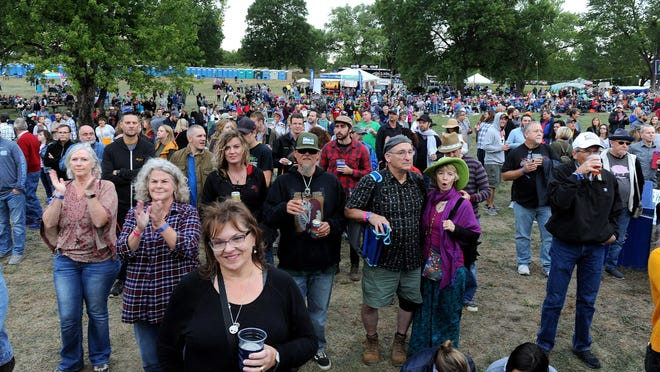The crowd at the 2018 Roots N Blues Festival listens to the Davy Knowles Band during a Friday evening show at Stephens Lake Park.