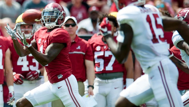 Alabama wide receiver Robert Foster (1) hauls in a long touchdown catch during the A-Day scrimmage game at Bryant Denny Stadium in Tuscaloosa, Ala., on Saturday April 22, 2017.