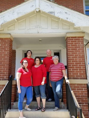 The five employees of Fremont's KeyBank showed their appreciation for community members and dedication to neighborhood prosperity by volunteering at the Village House.