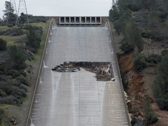 A hole opened on the Oroville Dam spillway Tuesday after a concrete section eroded. With Lake Oroville near capacity and more rain on the way, Department of Water Resources acting director Bill Croyle said the spillway would have to continue to run in a few days, despite the damage.