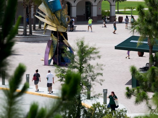 Potential students and their families walk throughout campus for freshman orientation Friday, July 14, 2017 at Florida Gulf Coast University in Fort Myers, Fla.