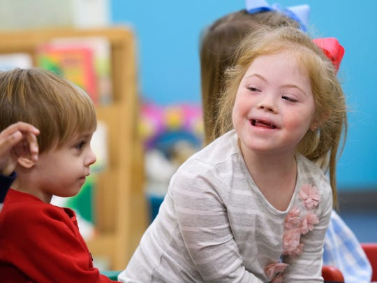 Lily Lape, right, enjoys a class exercise as classmate Mason Brunt looks on at Madison County Preschool in Ridgeland.