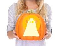 Woman holding jack-o-lantern